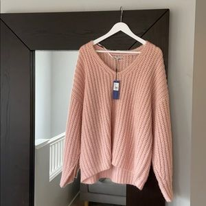 Soft pink sweater.
